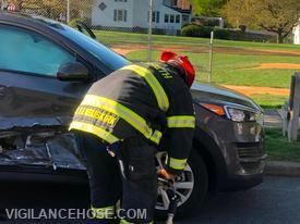 Lt. Wade VanBuskirk uses the Hurst hydraulic rescue tool to remove the door of a car involved in a 2-car crash.