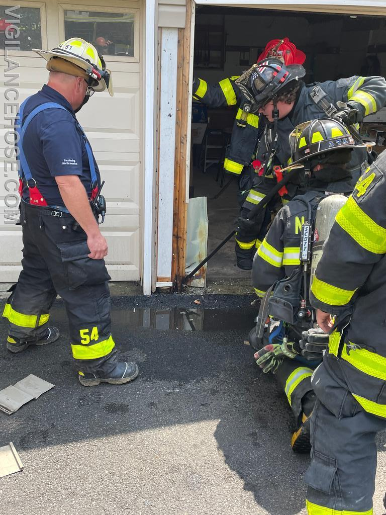 Crews working at a garage fire on Mauch Chunk St.
