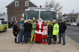 Santa and his helpers from the fire department.